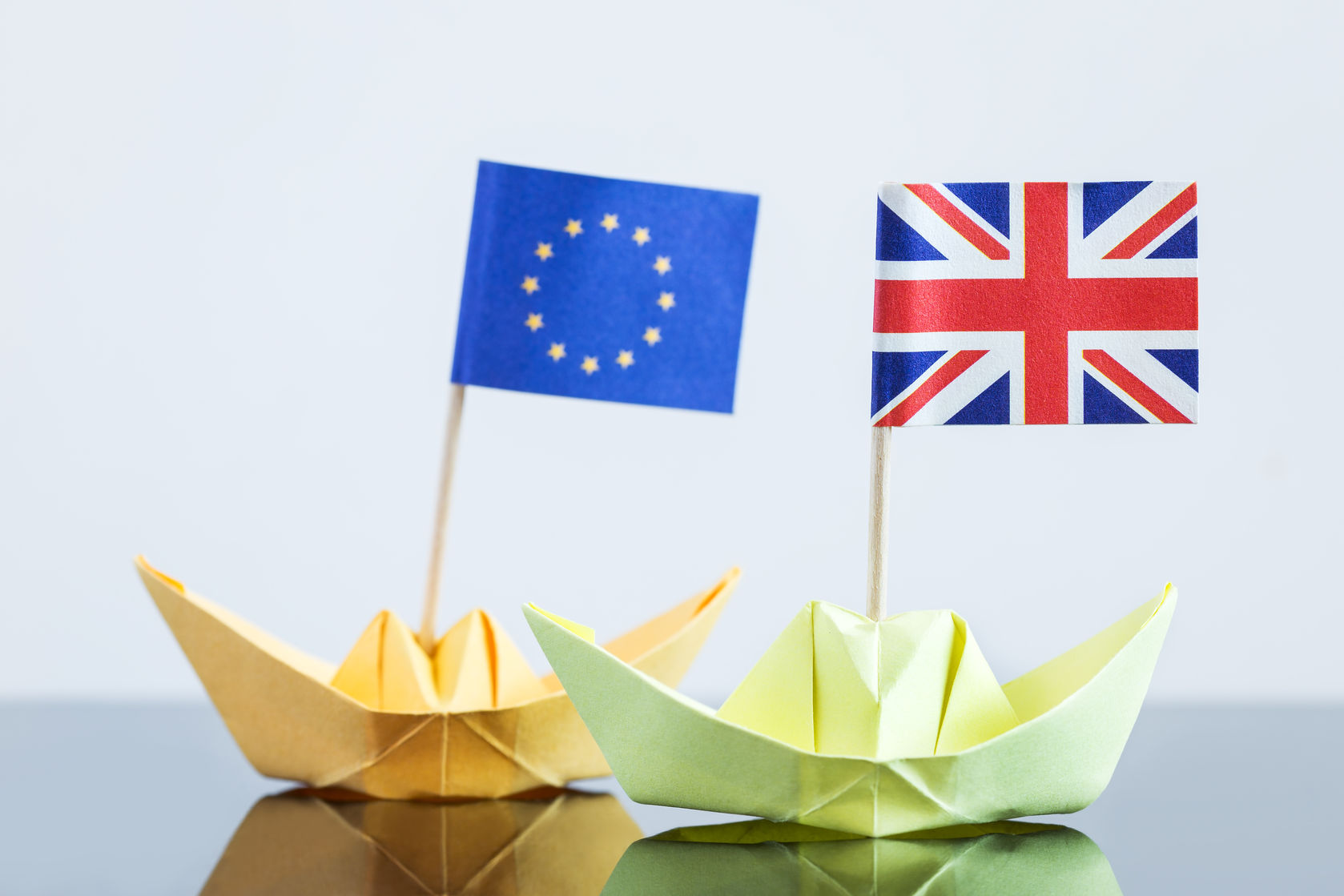 56911165 - paper ship with british and european flag, concept shipment or free trade agreement and membership of eu, brexit