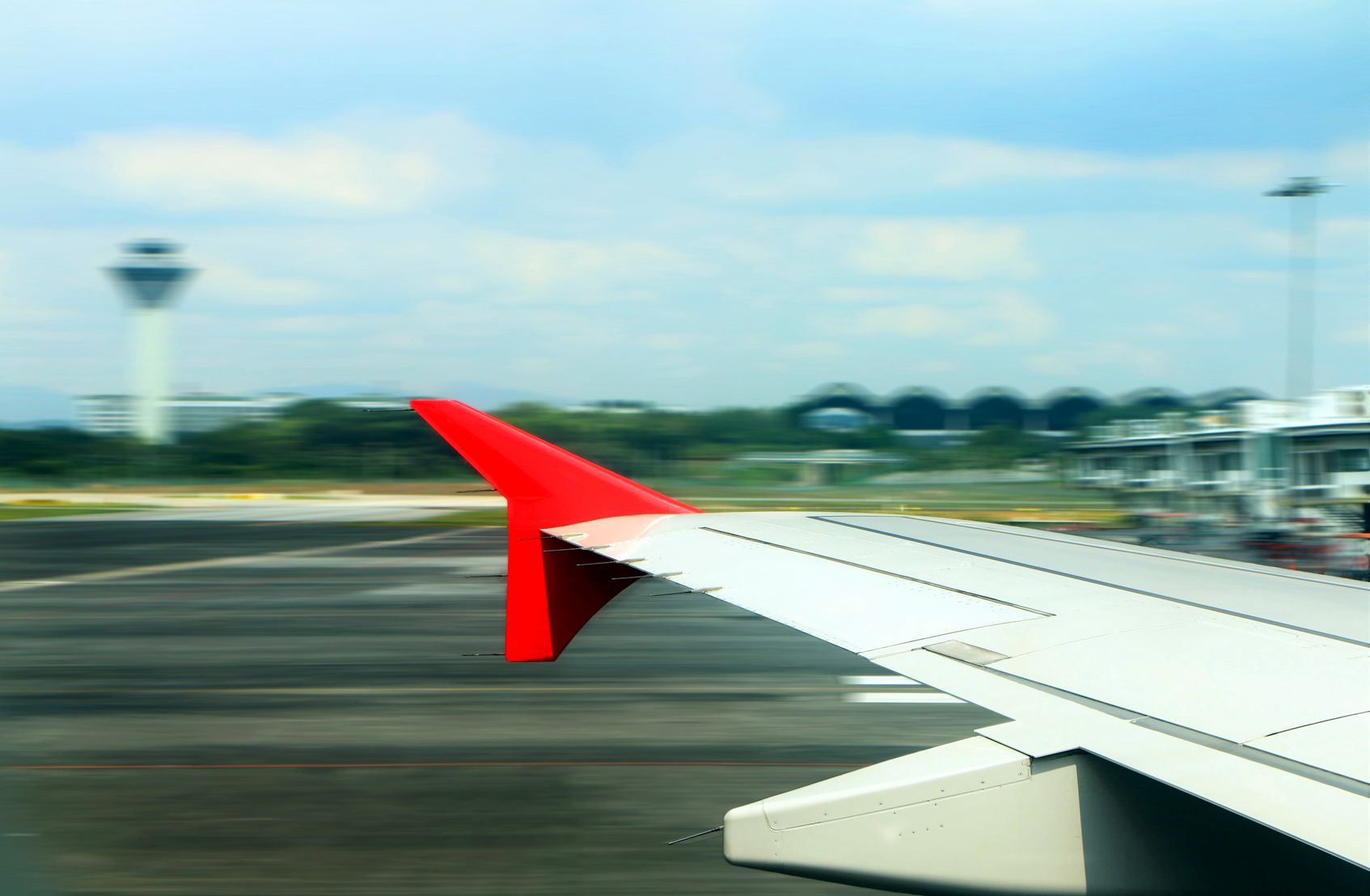 53591443 - airplane take off from window view with blur motion