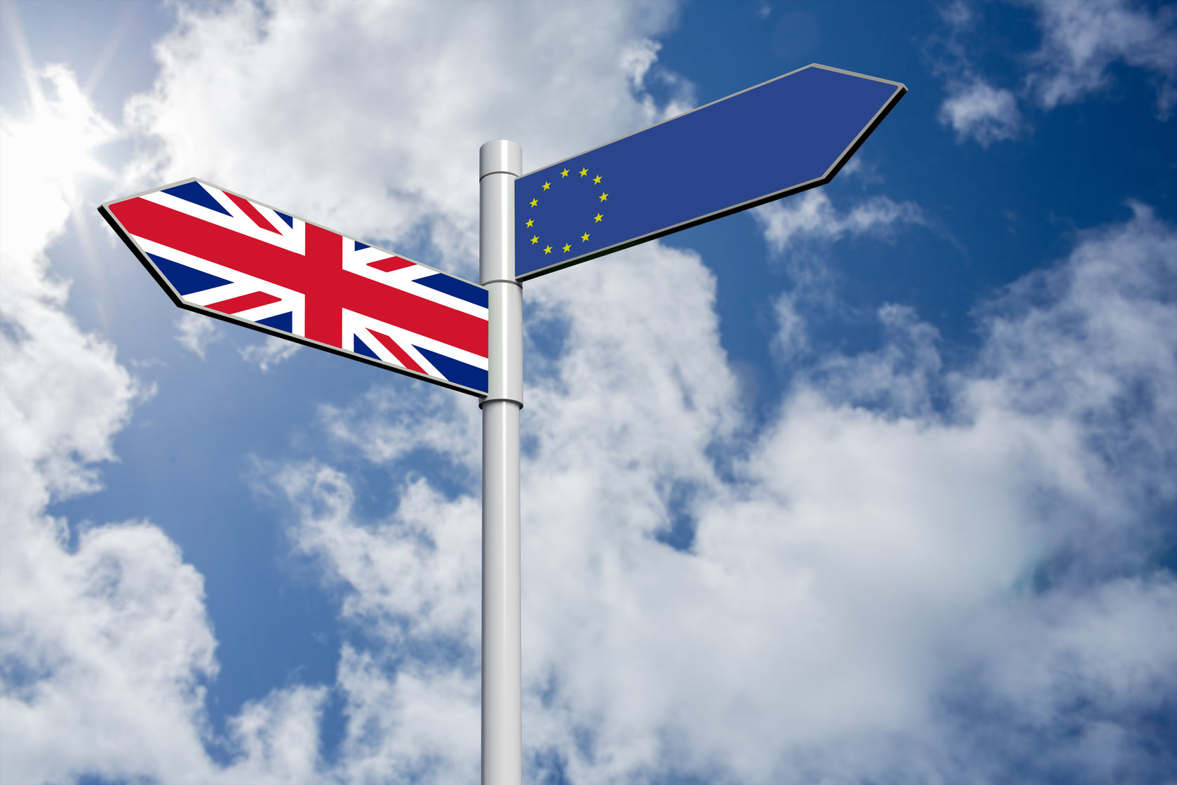61782630 - european union flag against bright blue sky with clouds